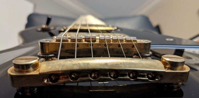 How To Spot A Fake Epiphone Les Paul - Tailpiece Bolt Heads